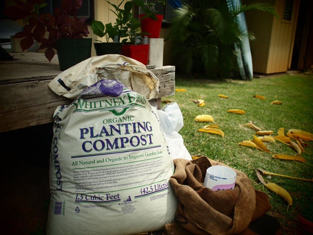 We started with compost, gravel, a burlap coffee sack and a large yogurt container with the bottom cut out.