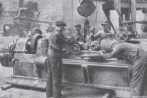A crew builds a concrete lathe for shaping shells during World War I in this photo that appeared in Machinery magazine in June, 1916.