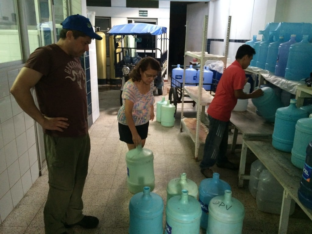 buying used & damaged water containers to make into male urinals