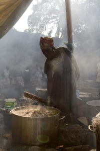 Haitian woman cooks