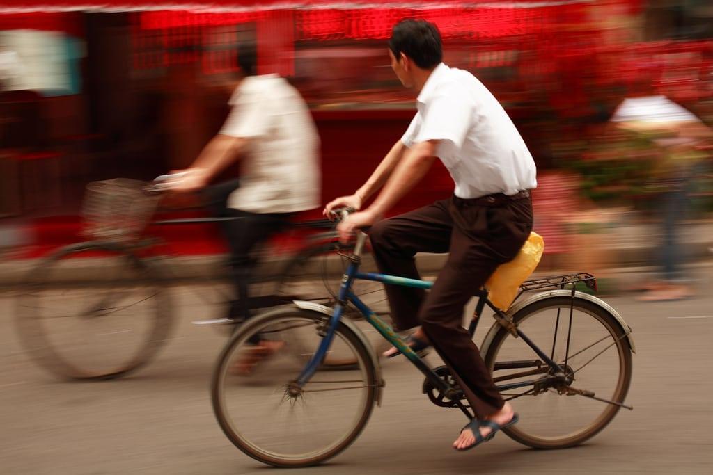Bicycle rider in Shanghai, China
