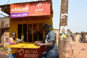 Mobile money transaction at agent's office in Uganda Picture credit: Fiona Graham / WorldRemit / Flickr (CC BY-SA 2.0)