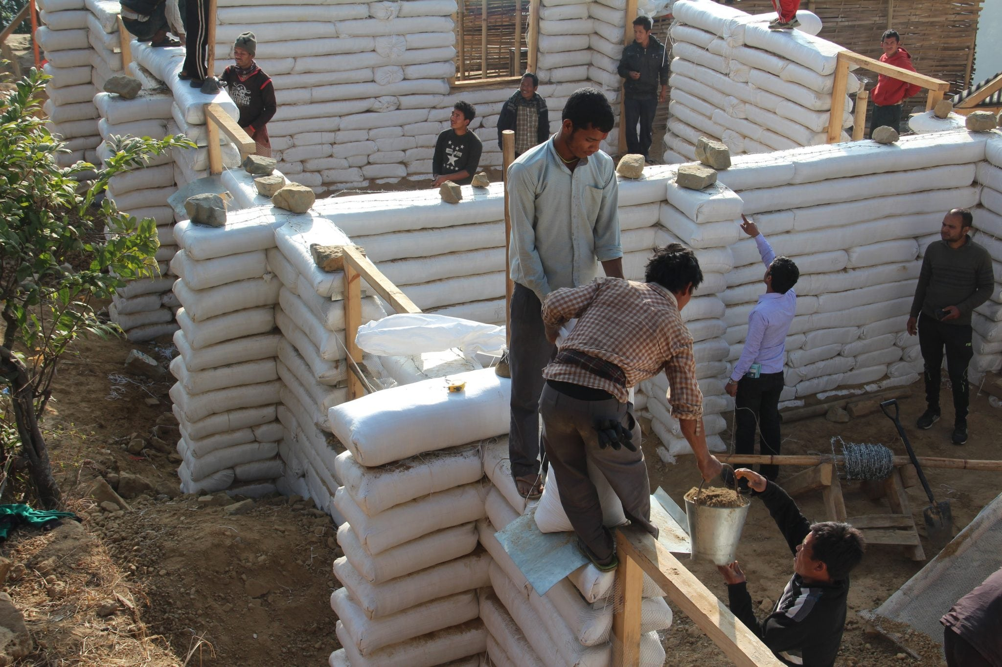 Earthbag Construction In Nepal Generally Employs A Rubble Trench Foundation  And A Lightweight Roof. Reinforcements Such As Corner And Wall  Reinforcements, ...