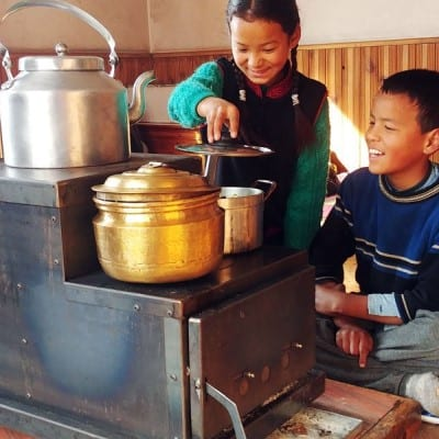 Eco1 Himalayan Rocket Stove being used by children