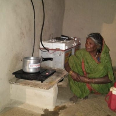 A woman using the Solar PV Cookstove