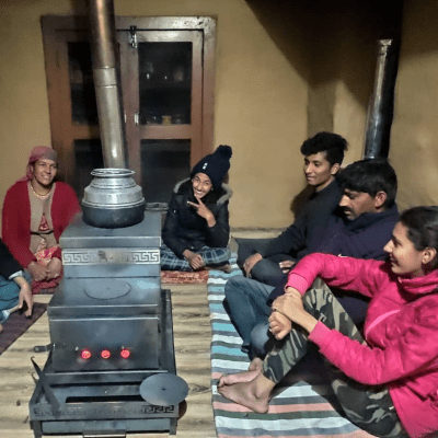 Himalayan Rocket Stove heating the room for a family